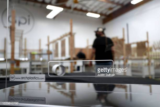 A newly manufactured acrylic social distancing guards sits on a table at Architectural Plastics on May 07 2020 in Petaluma California Architectural...