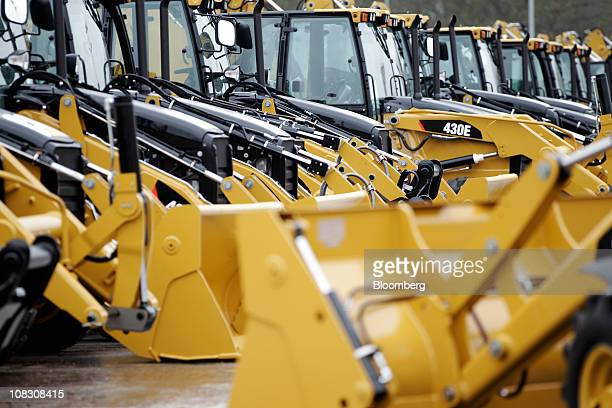 Newly manufactured Caterpillar Inc 'backhoe' diggers are parked ready distribution at the factory headquarters in Desford UK on Tuesday Jan 25 2011...