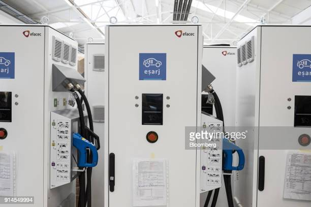 Newly manufactured electric vehicle 'esarj' recharging devices sit on display at the inauguration of Efacec Power Solutions SA's new electric...