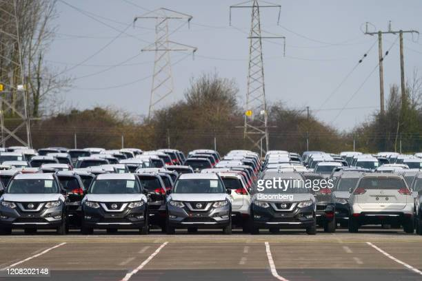 Newly manufactured Nissan Motor Co automobiles sit parked at the company's factory in Sunderland UK on Tuesday March 24 2020 Nissan suspended...