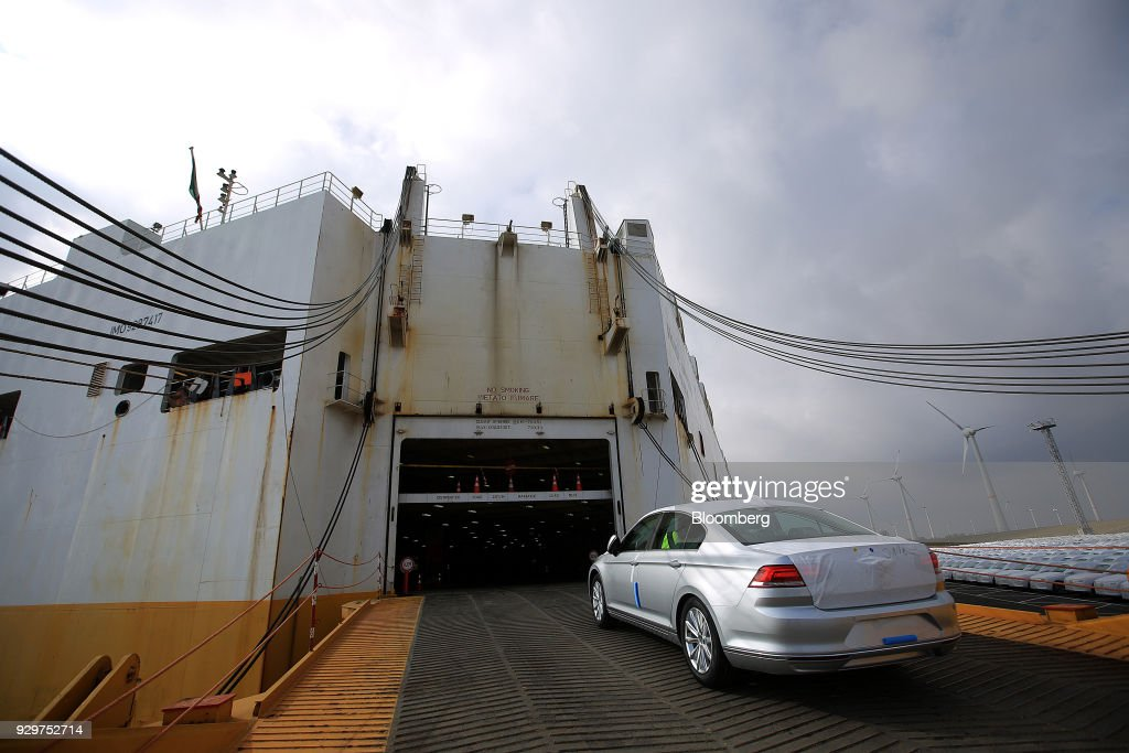 A newly manufactured Volkswagen AG (VW) Passat saloon automobile drives on board a roll-on/roll-off (RORO) vehicle carrier cargo ship for export at the port in Emden, Germany, on Friday, March 9, 2018. German carmaker VW will spend about 400 million euros ($495 million) to switch power plants at its Wolfsburg headquarters to gas from coal as it moves to slash carbon emissions in production. Photographer: Krisztian Bocsi/Bloomberg via Getty Images