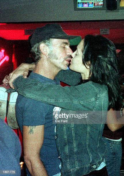 Newly married Billy Bob Thornton and Angelina Jolie kiss at Jerry''s Famous Deli June 3 2000 in Studio City CA