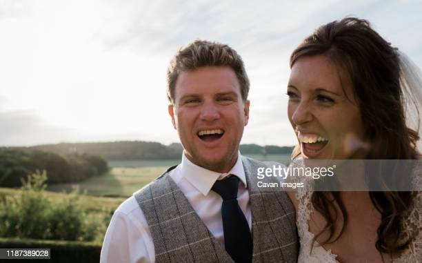 newly married couple, bride and groom laughing on their wedding day - beautiful people stock pictures, royalty-free photos & images