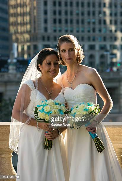 A newly married couple has their bridal photos taken outdoors along the Chicago River on October 10 2015 in Chicago Illinois Chicago the third...