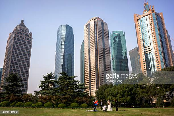 A newly married couple is taking wedding photos in the central park in Lujiazui financial and trade zone On Nov 17 the ShanghaiHong Kong Stock...