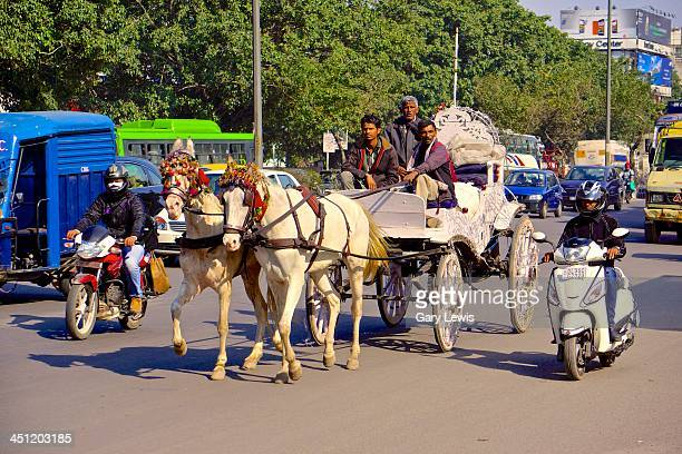 Newly married couples in modern New Delhi India, still desire a horse drawn wagon for there wedding.
