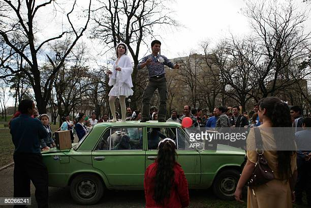 A newly married Gypsy couple from the Gypsies tinker minority dances during a traditional gypsy wedding ceremony at an openair market for Gypsy...