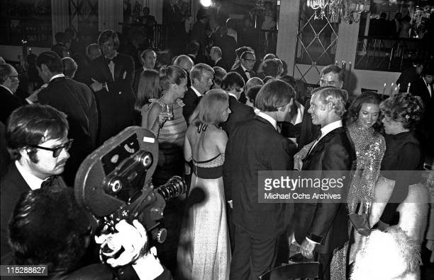Newly married Joanna and Johnny Carson host of the Tonight Show attend a party after taping the 10th anniversary show while a documentary crew...