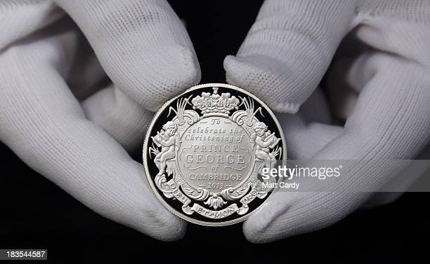 A newly minted coin to commemorate the christening of HRH Prince George of Cambridge is shown prior to going into production at The Royal Mint on...
