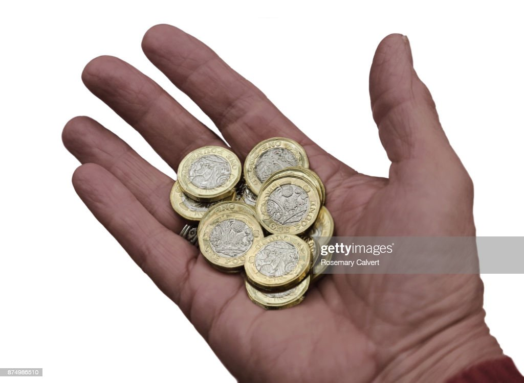 newly minted one pound coins in hand on white stock photo getty images