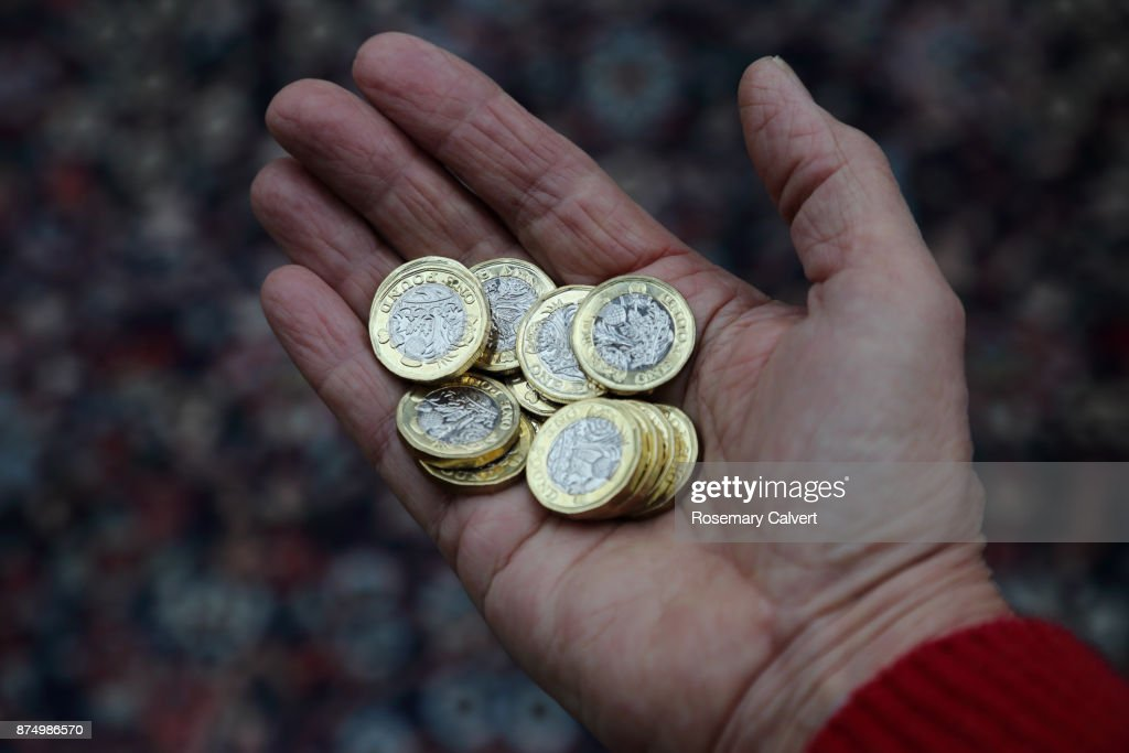 newly minted one pound coins in hand stock photo getty images