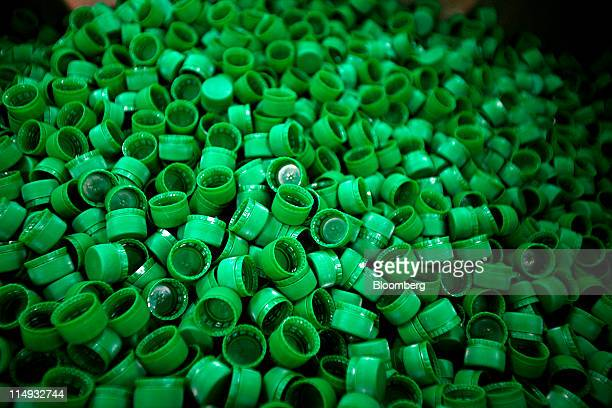 Newly molded polyethylene terephthalate bottle caps are seen at the Indorama Ventures Pcl factory in Kao Samoakoan Lopburi province Thailand on...