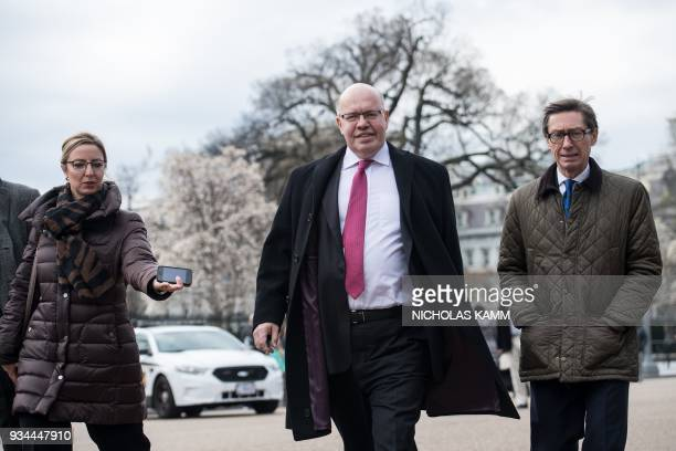 Newly named German Economy Minister Peter Altmaier arrives to speak to the press in front of the White House in Washington DC on March 19 2018 / AFP...