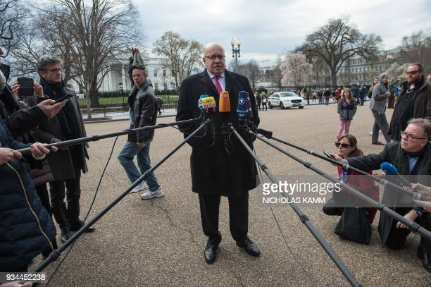 Newly named German Economy Minister Peter Altmaier speaks to the press in front of the White House in Washington DC on March 19 2018 / AFP PHOTO /...