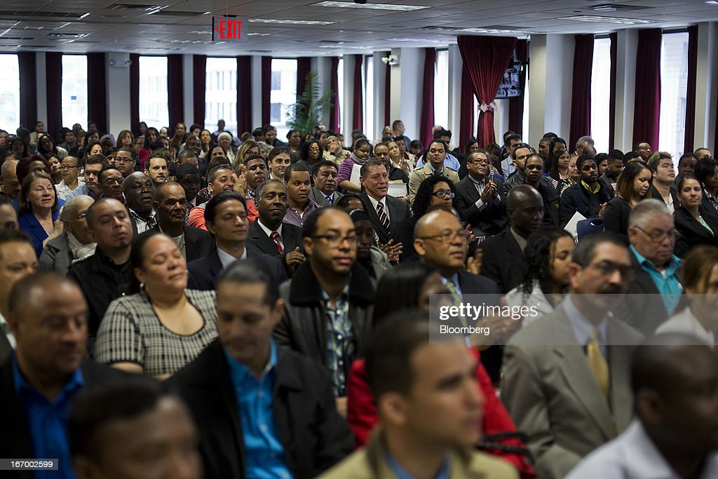 Newly naturalized American citizens attend a Naturalization Ceremony at the Jacob K. Javits Federal Building in New York, U.S., on Friday, April 19, 2013. A Senate plan to rewrite U.S. immigration law has stoked a years-old debate over allowing undocumented residents a chance to become citizens, a measure viewed by opponents as rewarding lawbreakers with 'amnesty' and undercutting American workers. Photographer: Victor J. Blue/Bloomberg via Getty Images