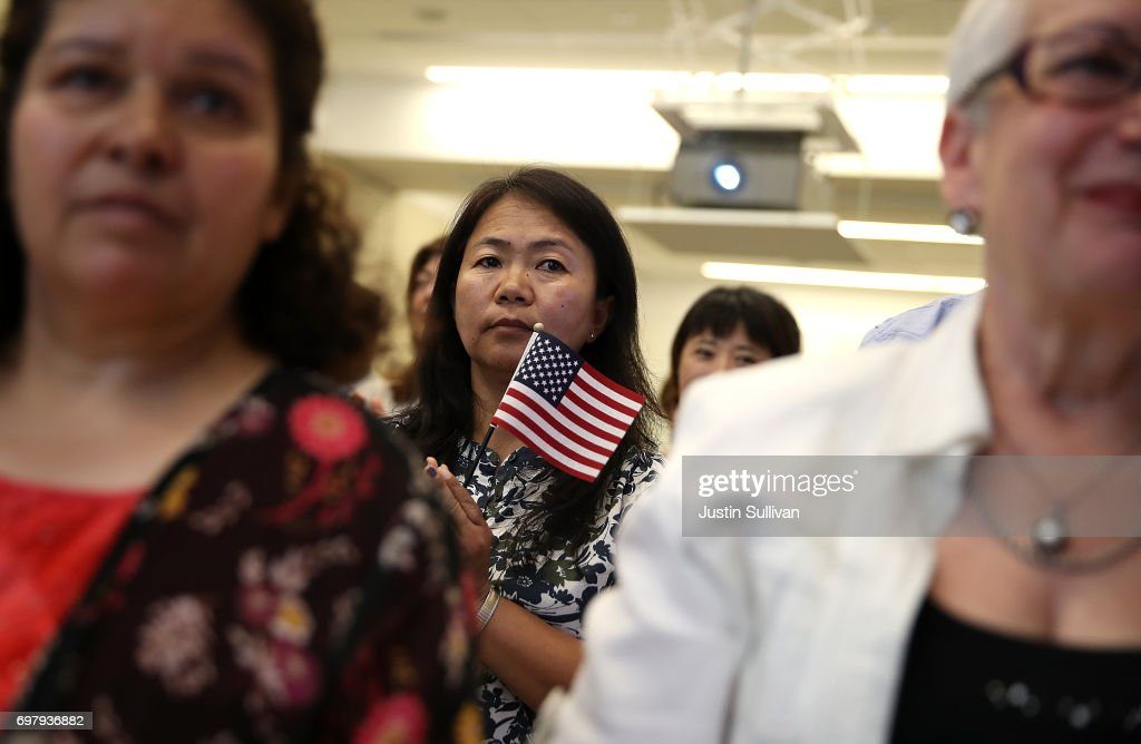 A newly naturalized citizen holds an American flags after being sworn in as American citizen during a naturalization ceremony on June 19, 2017 in San Francisco, California. 29 former refugees from 17 different countries were sworn in as Americaan citizens during a ceremony to mark World Refugee Day. World Refugee Day is Tuesday, June 20.
