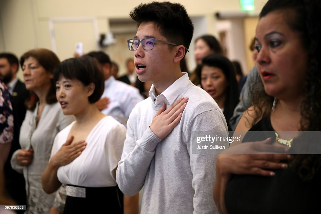 Newly naturalized citizens recite the Pledge of Allegiance during a naturalization ceremony on June 19, 2017 in San Francisco, California. 29 former refugees from 17 different countries were sworn in as Americaan citizens during a ceremony to mark World Refugee Day. World Refugee Day is Tuesday, June 20.