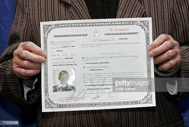Newly naturalized US citizen Chang Xiang of China holds her certificate of naturalization after being sworn in as a US citizen during a...