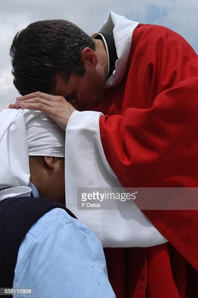 newly ordained priest blessing nun - nun stock-fotos und bilder