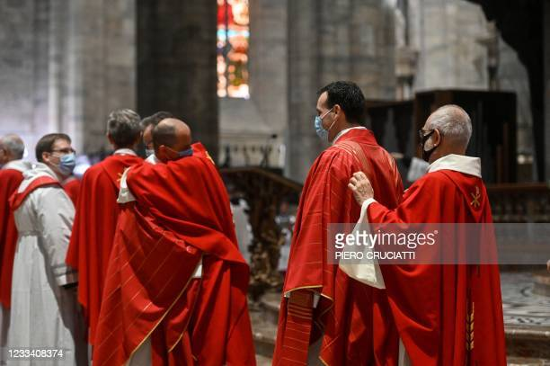 Newly ordered Catholic priests are dressed during an ordination mass in the Duomo Cathedral, on Milan, on June 12, 2021.