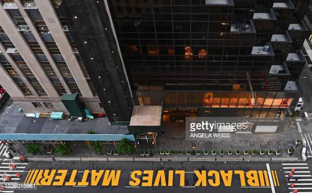 A newly painted Black Lives Matter mural adorns Fifth Avenue outside of Trump Tower on July 10 2020 in New York City
