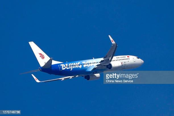 A newly painted Boeing 737 aircraft of Air China with patterns of the emblems and mascots of Beijing 2022 Winter Olympics takes off from Beijing...
