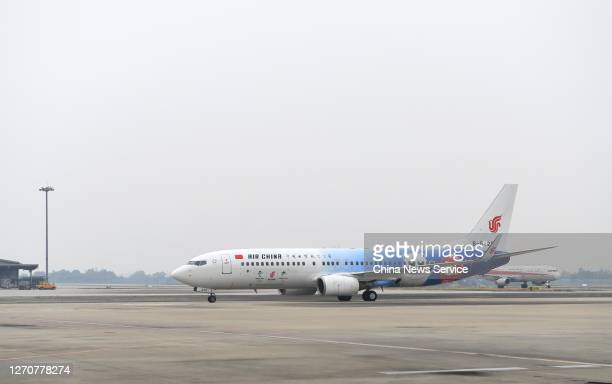 A newly painted Boeing 737 aircraft of Air China with patterns of the emblems and mascots of Beijing 2022 Winter Olympics lands at Shuangliu...