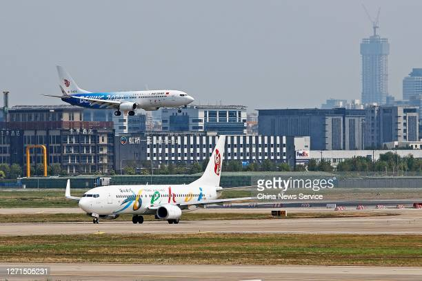 A newly painted Boeing 737 aircraft of Air China with patterns of the emblems and mascots of Beijing 2022 Winter Olympics lands at Hongqiao...