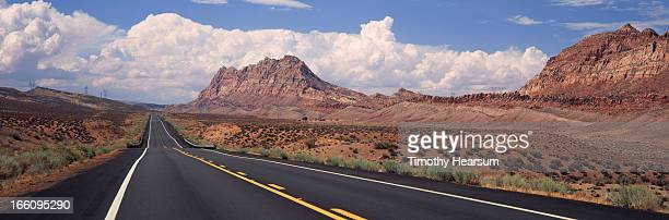newly paved road through red rock formations - timothy hearsum stock-fotos und bilder