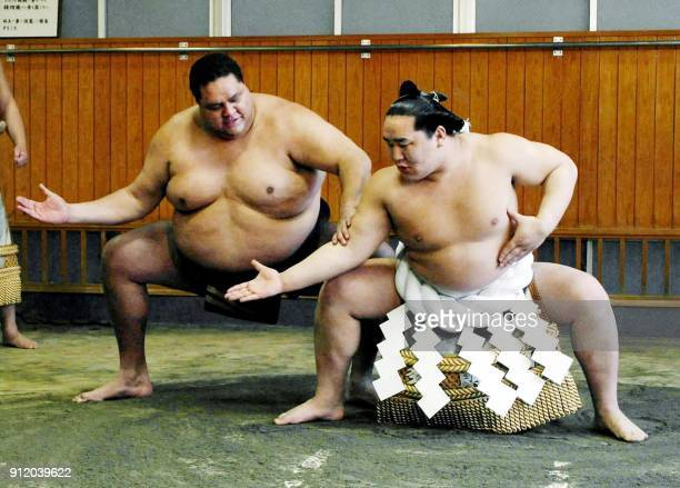 Newly promoted Mongolborn 'Yokozuna' grand champion Asashoryu takes a lesson of 'DohyoIri' a ceremonial stumping from exYokozuna Akebono from Hawaii...