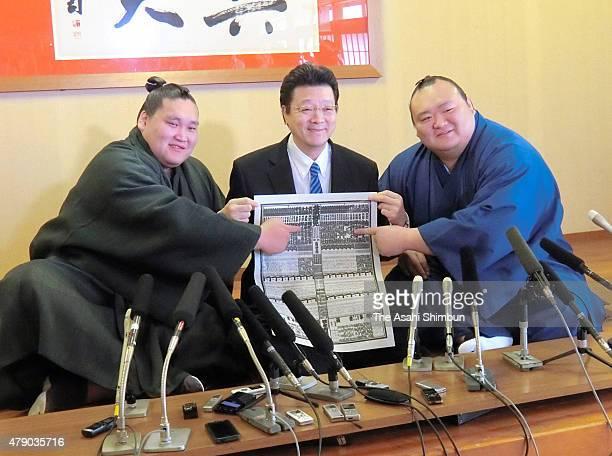 Newly promoted Mongolian Ozeki Terunofuji Stablemaster Isegahama and newly promoted Komusubi Takarafuji pose for photographs with the new Sumo...