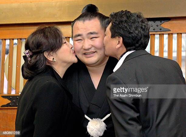 Newly promoted Mongolian yokozuna Kakuryu whose real name is Mangaljalavyn Anand is kissed by his parents on March 26 2014 in Osaka Japan