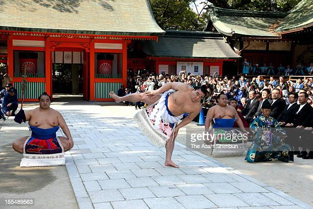 Newly promoted Mongolian yokozuna sumo champion Harumafuji whose real name is Davaanyamyn Byambadorj performs 'Dohyoiri' ringpurification ritual at...