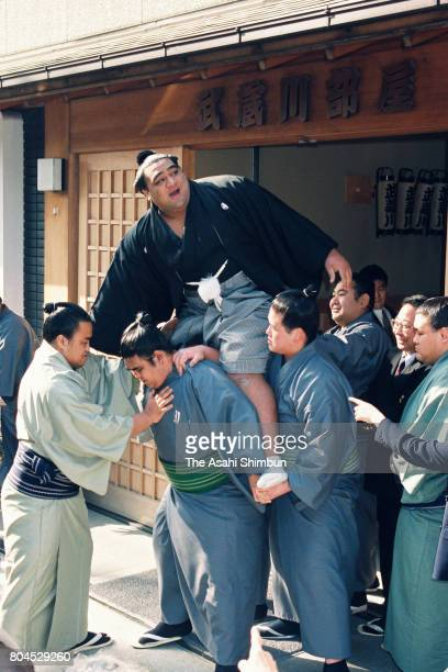 Newly promoted ozeki Musashimaru is lifted by fellow wrestlers in front of Musashigawa Stable on January 26, 1994 in Tokyo, Japan.