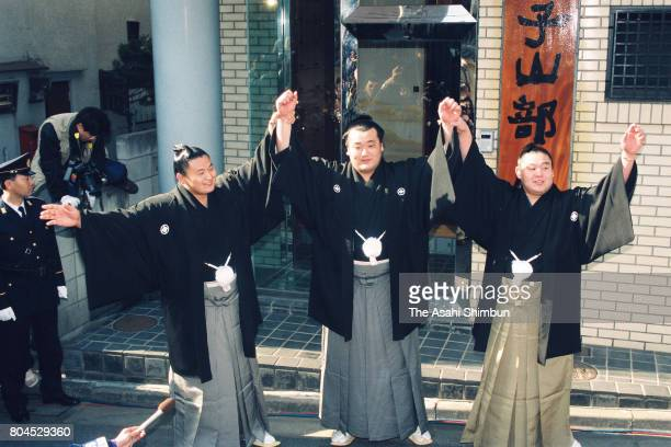 Newly promoted ozeki Takanonami celebrates with fellow ozeki Takanohana and Wakanohana in front of Futagoyama Stable on January 26 1994 in Tokyo Japan