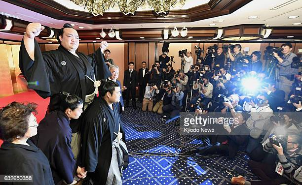 Newly promoted yokozuna Kisenosato poses for photos in Tokyo on Jan 25 2017 The 30yearold became the 72nd yokozuna in sumo history and the first...