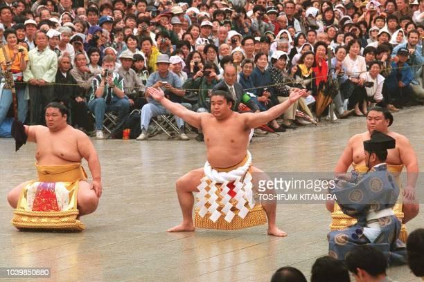 Newly promoted Yokozuna Wakanohana performs 'shiranui dohyoiri' with swordbearer Akinoshima and dewsweeper Takatoriki during a grand champion...