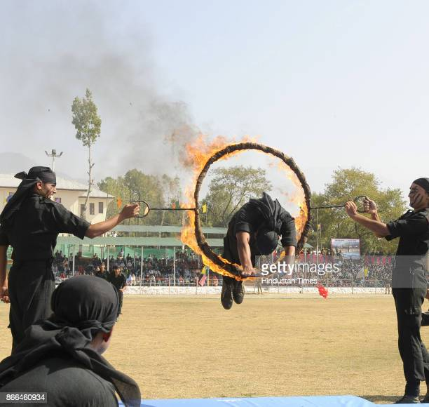 A newly recruit of Jammu and Kashmir Police man passing through fire ring during a passingout parade at Manigam on October 25 2017 in Ganderbal India...