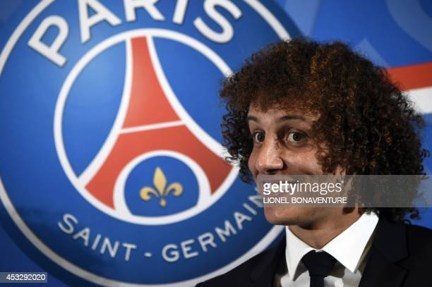 PSG newly recruited Brazilian defender David Luiz poses during his official presentation on August 7 2014 in Paris Luiz signed in June a 5year...