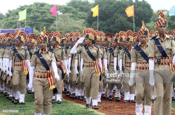 Newly recruited constables of the first batch State Industrial Security Force take salute to the national flag of India after taking oath in their...
