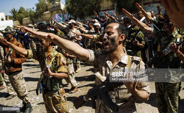 Newly recruited Houthi fighters chant slogans during a gathering in the capital Sanaa to mobilize more fighters to battlefronts to fight...
