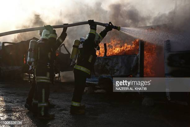 Newly recruited members of the Syrian civil defence take part in fire training exercises in the Syrian town of Marea in the northern Aleppo district...