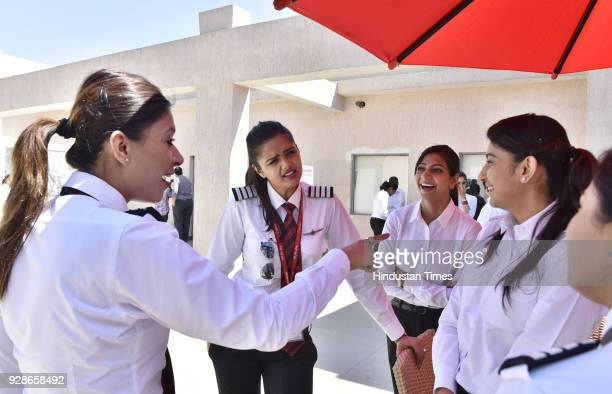 Newly recruited women pilots share a light moments with each other on the eve of Women's Day at SpiceJet Training Academy Udyog Vihar Phase on March...