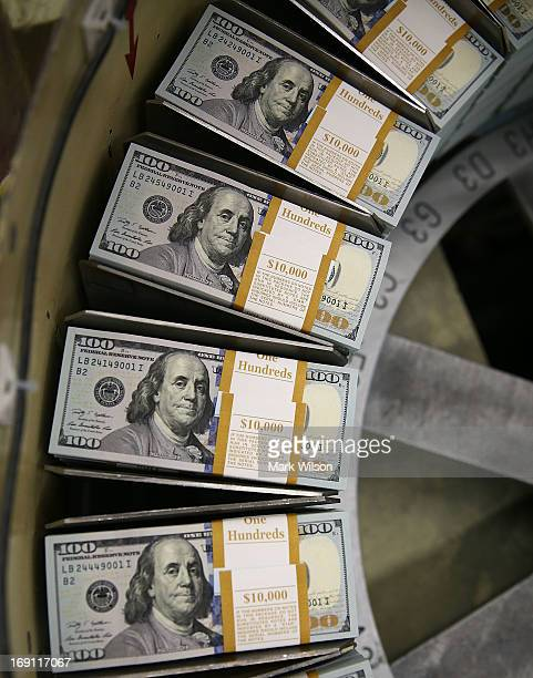 Newly redesigned $100 notes are printed at the Bureau of Engraving and Printing on May 20 2013 in Washington DC The one hundred dollar bills will be...