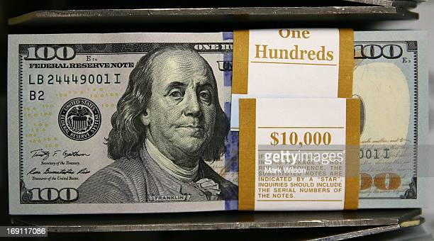 Newly redesigned $100 notes lay in stacks at the Bureau of Engraving and Printing on May 20 2013 in Washington DC The one hundred dollar bills will...