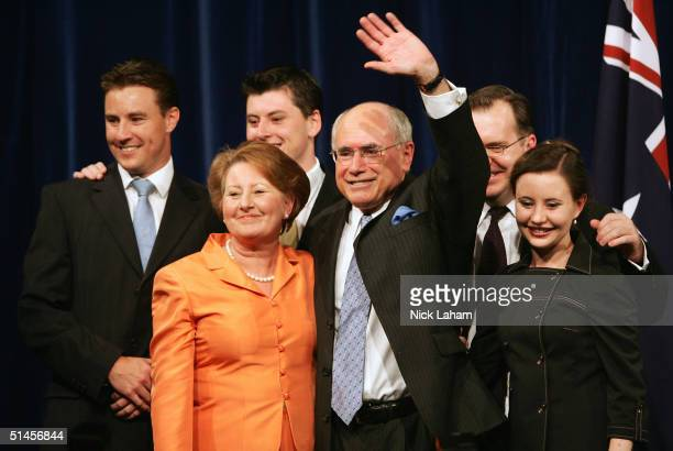 Newly reelected Australian Prime Minister John Howard and his family acknowledge the crowd after delivering his acceptance speech during the Liberal...