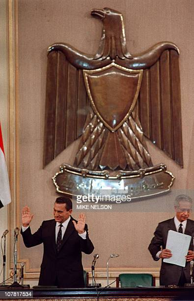 Newly reelected Egyptian President Hosni Mubarak addresses 12 October 1987 in Cairo the new government at the People's Assembly on the first day of...