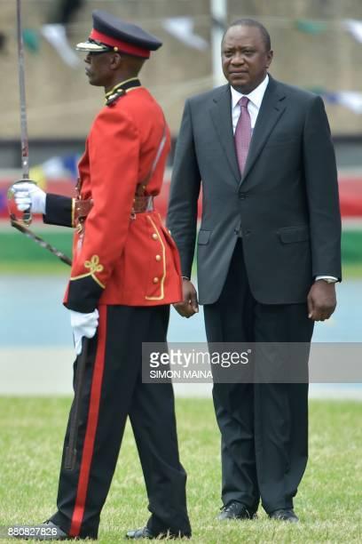 Newly reelected Kenyan President Uhuru Kenyatta reviews a guard of honour during his swearing in ceremony at Kasarani Stadium on November 28 2017 in...