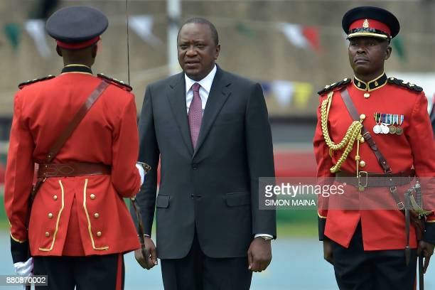 Newly reelected Kenyan President Uhuru Kenyatta reviews a guard of honour during his inauguration ceremony for a second term at Kasarani Stadium on...