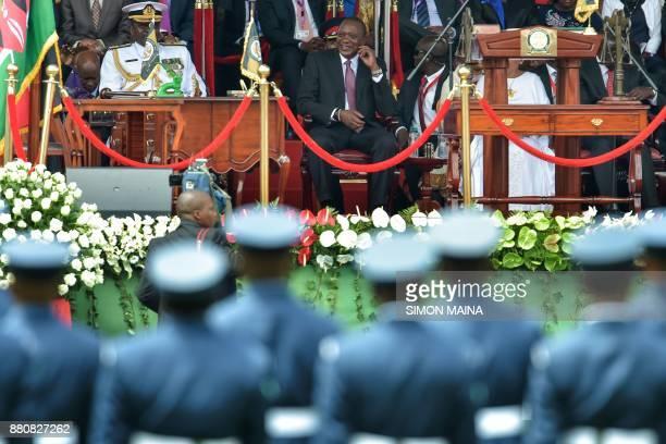 Newly reelected Kenyan President Uhuru Kenyatta smiles during his swearing in ceremony at Kasarani Stadium on November 28 2017 in Nairobi Kenyatta...